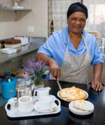 Doris preparing to serve tea