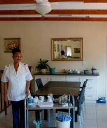 Nurse Orapet serving tea at Frail Care